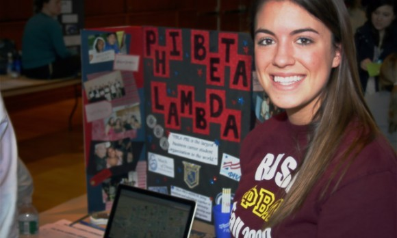Emily Fenimore of Phi Beta Lamda invites business men and women to join her Fraternity