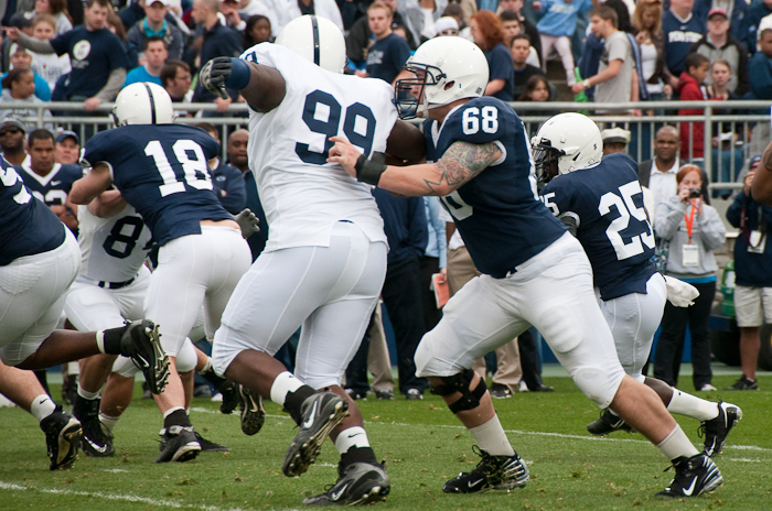 Senior center Doug Klopacz blocks against sophomore defensive end Brandon Ware for freshman running back Silas Redd.