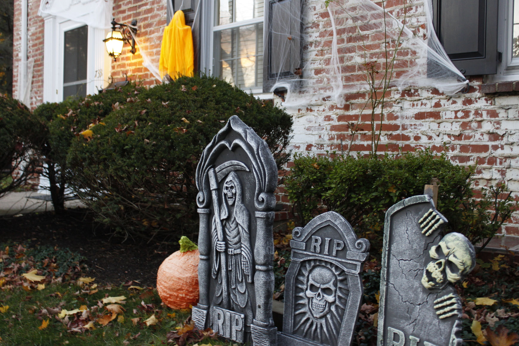 A few tombstones add some seasonal spookiness to a local State College house.