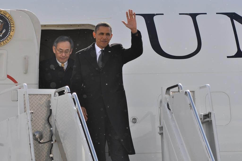 President Obama waves to the press line.