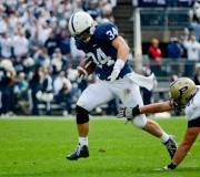 Linebacker Nathan Stupar returns his first of two interceptions.