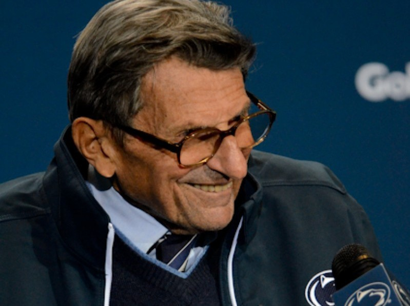 Coach Joe Paterno laughs during his postgame press conference.