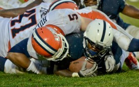 Silas Redd is tackled during the 4th quarter