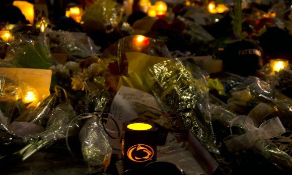 Candles illuminate the Joe Paterno statue Sunday night after the news of his death earlier that morning.