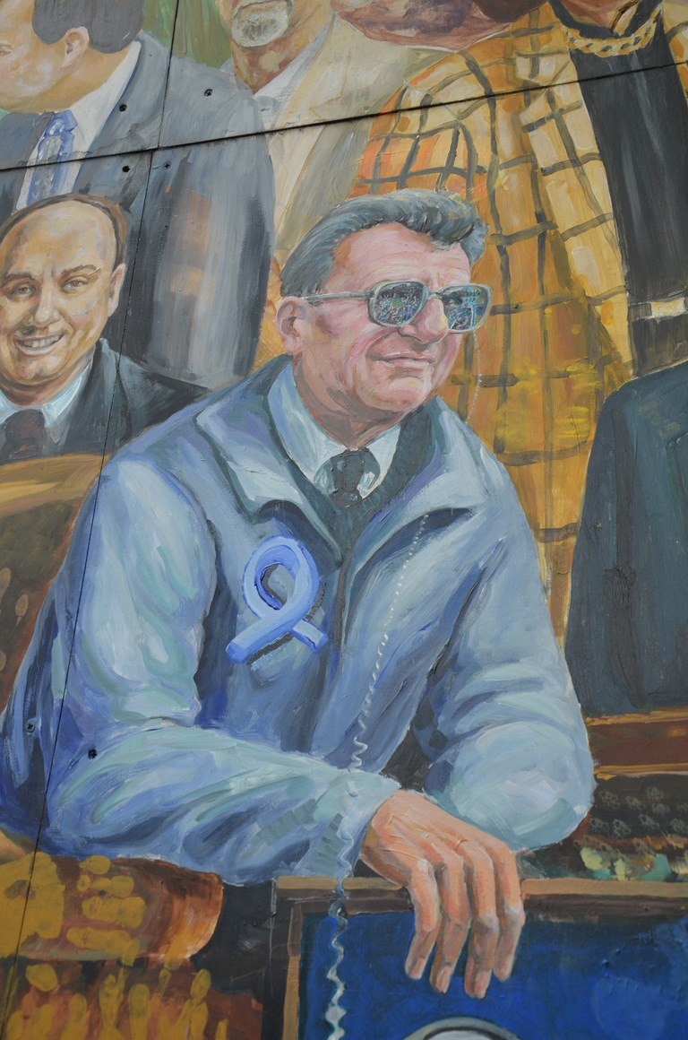 "Artists Michael Pilato and Yuriy Karabash have painted over the halo that once stood above Joe Paterno's head on their Heister Street mural entitled ""Inspire."""