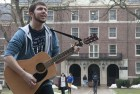 Penn State sophomore Alex Kulwik aka the Guitar Man sings outside of Thompson Hall.