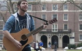 Penn State sophomore Alex Kulwik aka the Guitar Man sings outside of Thompson Hall.