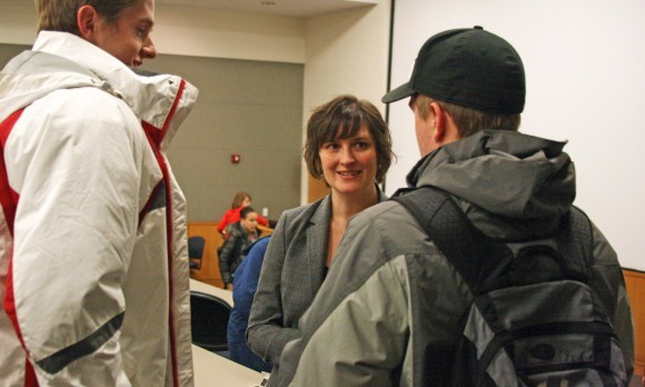 Sandra Fluke talks to two students after her talk on Tuesday