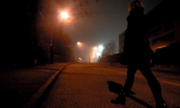 girl walking alone at night