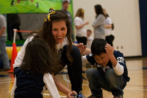 Family Relations Captain Aly Young plays games with THON children. (Photo by: Bobby Chen.)