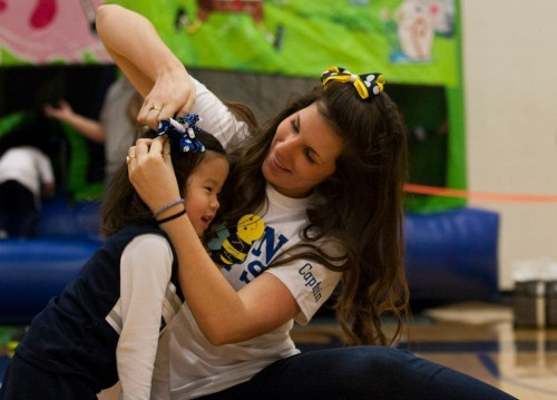 Young takes a brief timeout to fix a THON child's bow. (Photo by: Bobby Chen)
