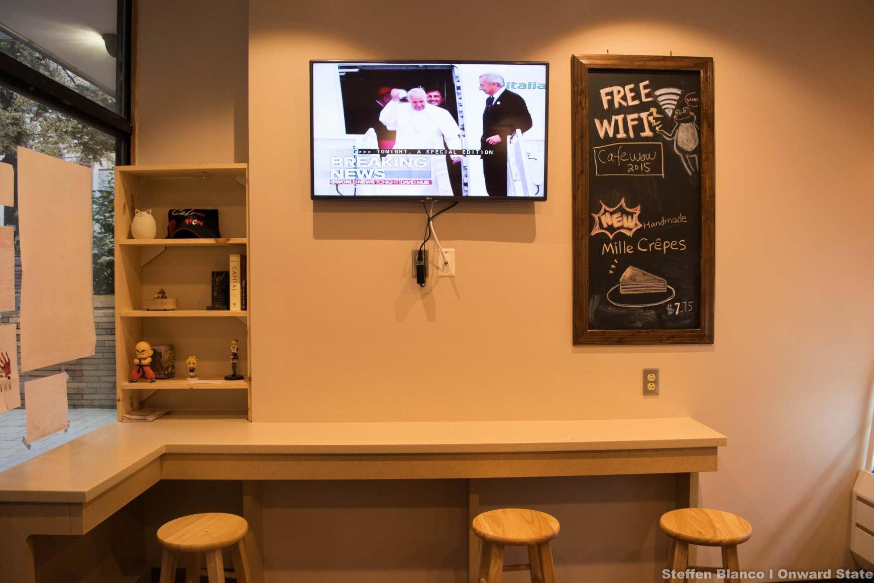 these cool anime figurines along with the cafe wow swag really give the restaurant some character - Flat Panel Cafe 2015
