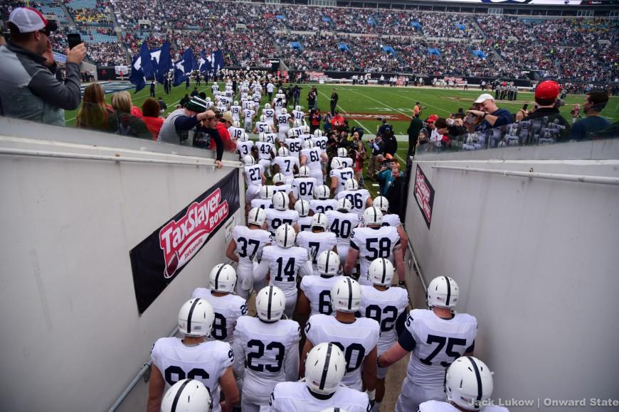 Team Rushing the Field Football Taxslayer Bowl Georgia 2016 Stock