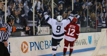 alex robinson men's hockey pegula stock david goodwin goal celebration overtime wisconsin game winning